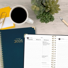 AT-A-GLANCE Harmony Planner on desk with coffee